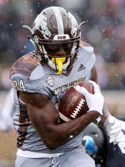Western Michigan's Corey Davis runs with the ball in the first quarter against the Buffalo Bulls at Waldo Stadium Saturday.