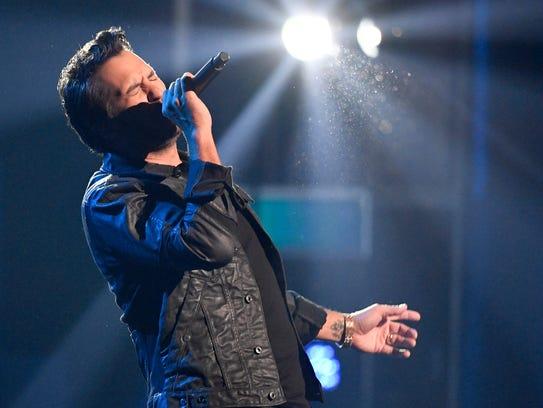 Luke Bryan performs during the CMA Awards at Bridgestone