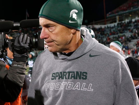 Michigan State coach Mark Dantonio walks off the field following his team's 49-37 loss to Ohio State in an NCAA college football game, Saturday, Nov. 8, 2014, in East Lansing, Mich. (AP Photo/Al Goldis)