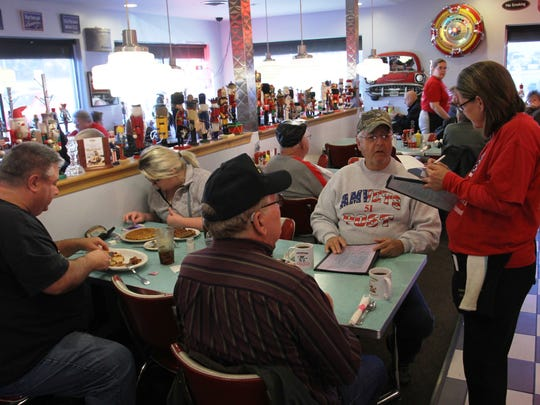 U.S. Air Force veterans Ron Stokes and Roy Ryan order breakfast Friday at the Nutcracker Family Restaurant. The Pataskala residents were two of the hundreds of veterans expected to visit the restaurant, which hands out free meals to veterans each Veterans Day.