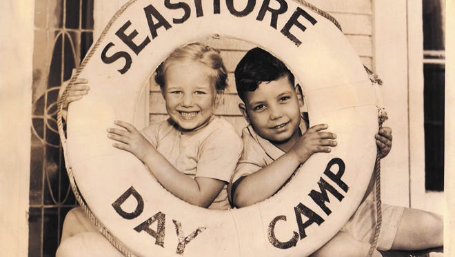 An undated photo of Sea Shore Day Camp campers posing in a life ring.