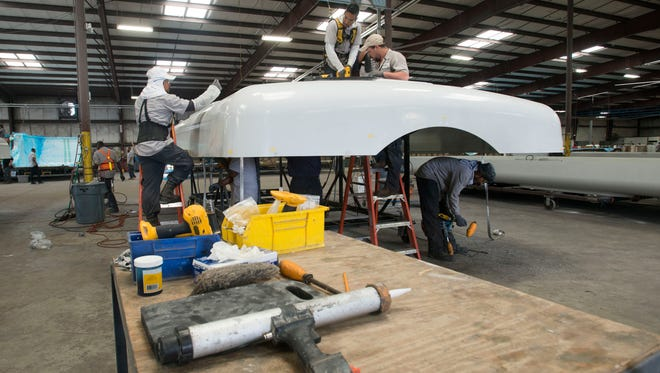 Employees at the Jupiter Group in Ellyson Industrial Park work to complete construction on a wind turbine parts. As the demand for renewable energy increasing, the demand for products produced by Jupiter is growing.
