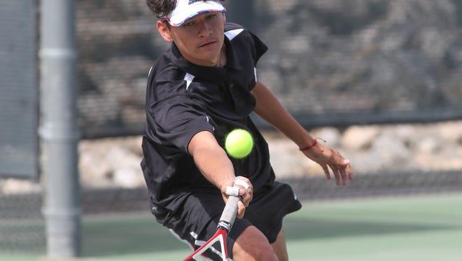 Eduardo Contreras of Desert Hot Springs plays tennis against Citrus Valley High School, May 8, 2018.