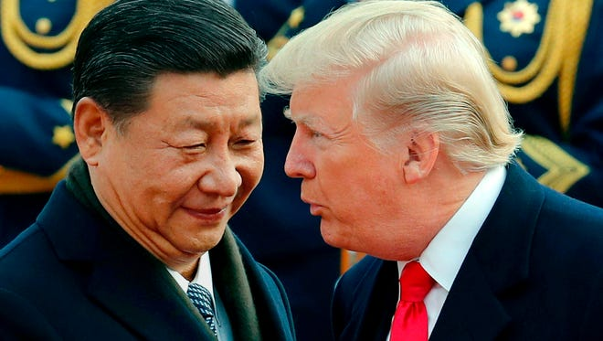 President Trump chats with Chinese President Xi Jinping during a welcome ceremony at the Great Hall of the People in Beijing on Nov. 9, 2017.
