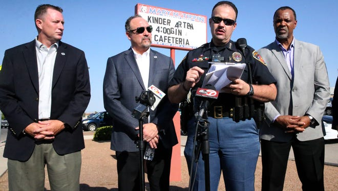 El Paso Independent School District police Chief Victor Araiza, second from right, speaks to the media outside Tippin Elementary School with then-school board President Trent Hatch, left, and school district Superintendent Juan Cabrera, second from left, and Vince Sheffield, deputy superintendent of administration, at right.