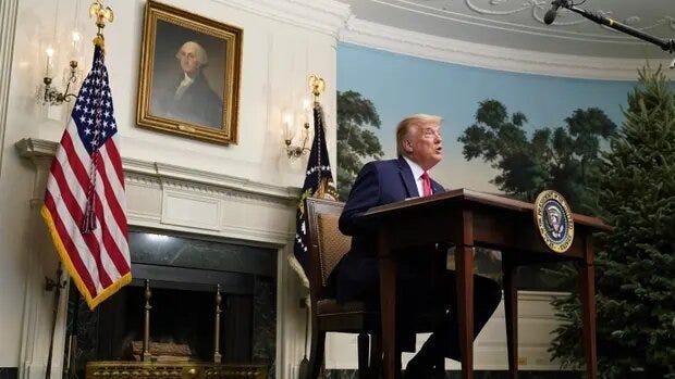 Donald Trump photographed at a tiny desk