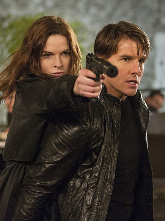 """Rebecca Ferguson, left, and Tom Cruise appear in a scene from """"Mission: Impossible — Rogue Nation."""""""