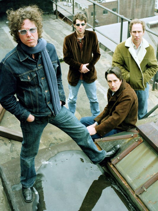 Members of the Jayhawks pose on a roof in New York in this file photo. From left, are, Gary Louris, Marc Perlman, Stephen McCarthy, and Tim O'Reagan.