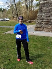 Chambersburg's Jolene McLucas poses for a photo after completing the Buck Ridge Burn 5K last weekend.