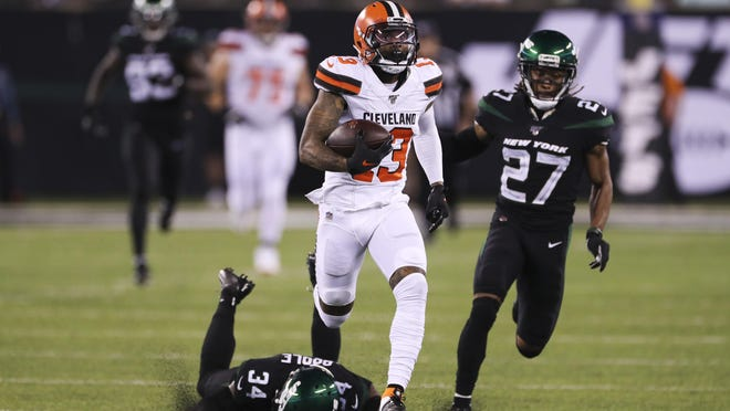 Browns wide receiver Odell Beckham Jr. scores on an 89-yard touchdown reception against New York Jets cornerback Brian Poole and cornerback Darryl Roberts, left, during the second half a game in September.