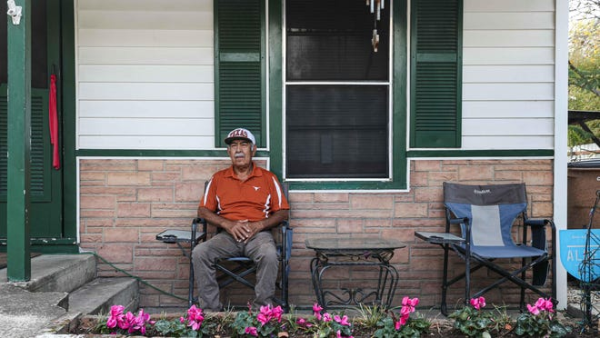 Gilbert Martinez, 68, poses in front of his home, which his late in-laws purchased for $150 a month.