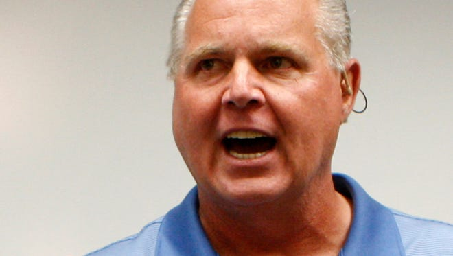 Conservative talk show host Rush Limbaugh speaks during a news conference, Jan. 1, 2010.