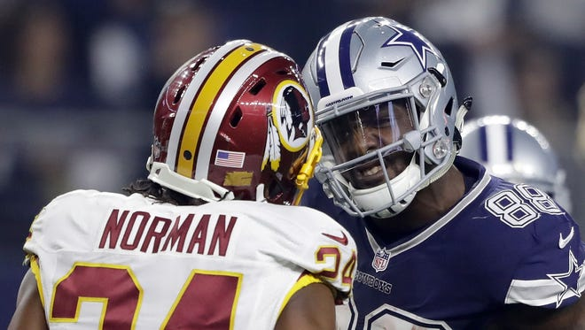 Dez Bryant of the Dallas Cowboys argues with Josh Norman #24 of the Washington Redskins after catching a pass in their game at AT&T Stadium on November 24, 2016 in Arlington, Texas.