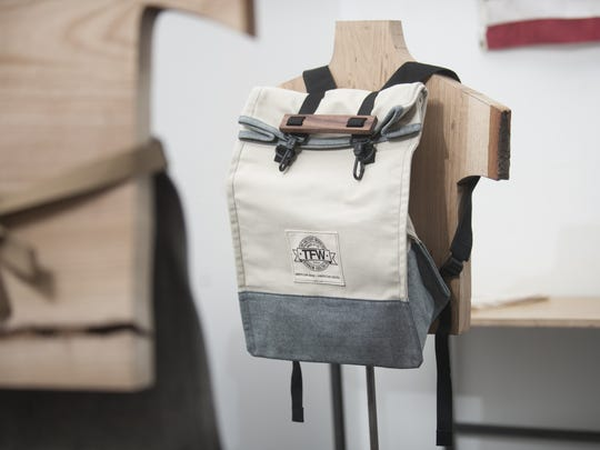 A backpack from The Factory Workers line of clothing and accessories is displayed at The Factory in Collingswood.