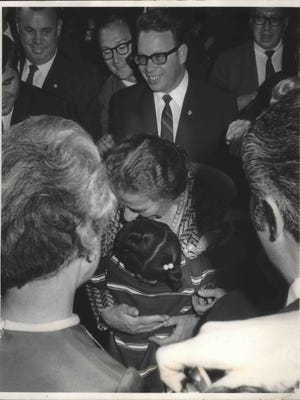 On a return visit to Milwaukee where she grew up, Israeli prime minister Golda Meir hugs a child at her former elementary school, now named after her.