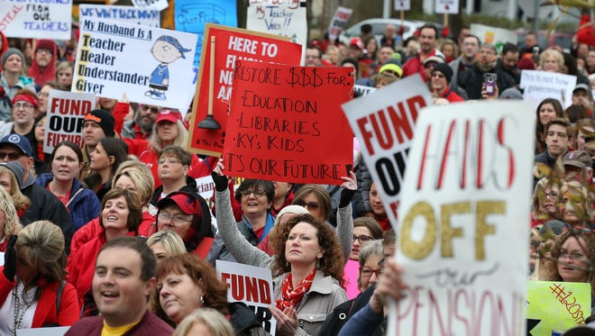 Thousands gather in front of the Kentucky Education on Monday morning, most of them teachers, to rally agains the pension reform legislation passed by legislators on Thursday night.