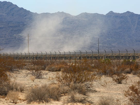 A whirlwind of dust forms over the McCoy solar project