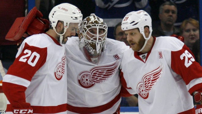 Detroit Red Wings goalie Jimmy Howard gets helped off of the ice after he was injured against the Tampa Bay Lightning on Tuesday, Dec. 20, 2016.