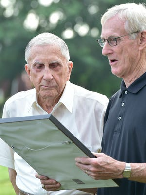 Jim Strite, right, reads a proclamation for Paul Kriner. The flag pole at Norland Cemetery was dedicated on Monday, August 1, 2016 to Paul K. Kriner, a WWII and Korean War veteran. Kriner is also a life member of the VFW Honor Guard and is also celebrating his 100th birthday on August 7.