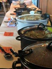Soup sits in crockpots as part of a St. Cloud Soup