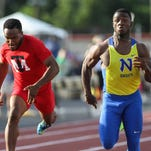 Northwest's DeVohn Jackson, right, easily wins the 100-meter dash at the Division I regional finals at Welcome Stadium.