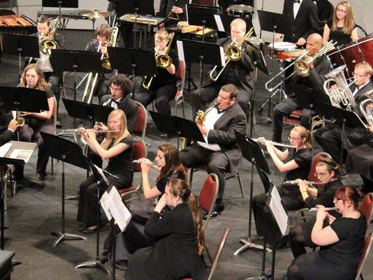 Dr Adam Lambert conducting the SUU Wind Symphony by Amanda Billings.jpg