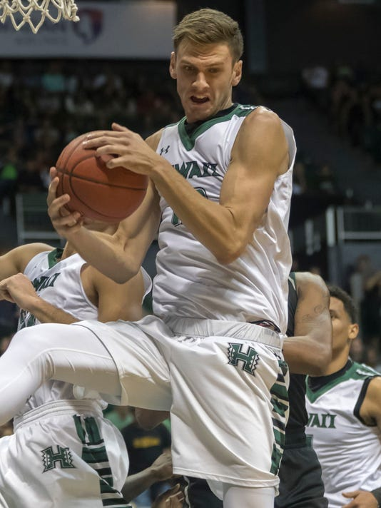 Hawaii forward Jack Purchase (12) controls a rebound while playing against Miami during the first half of an NCAA college basketball game at the Diamond Head Classic tournament, Friday, Dec. 22, 2017, in Honolulu. (AP Photo/Eugene Tanner)