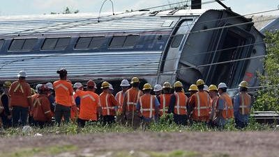Rescuers gather around a derailed carriage of an Amtrak train in Philadelphia, on May 13.
