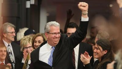 Democrat Ted O'Brien celebrates winning a state Senate seat in 2012. He was unseated two years later by Republican Rich Funke.