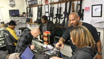 Kordell Jackson, former owner of Jackson Guns and Ammo, upper right.