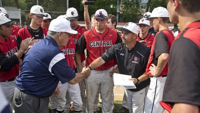 Hunterdon Central head coach Mike Raymond (right) is congratulated after Hunterdon Central defeated Morristown in the NJSIAA Group IV final on June 11, 2016.