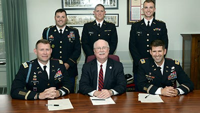 Participating in the signing ceremony were (seated, from left) Col. Kenneth Mintz, commander of the U.S. Army 2nd ROTC Brigade; Dr. Jody Harpster, Shippensburg University president; Maj. Christopher Morton, chair of the university's Department of Military Science; (standing from left) Sgt. 1st Class Matthew Wright, military science instructor; and Cadets Michael Rycyzyn and Daniel Kinney.
