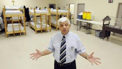 Former Friendship Mission director Vincent Rosato stands in the men's shelter on Mobile Highway.