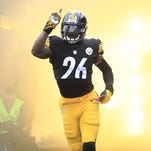 Pittsburgh Steelers running back Le'Veon Bell (26) reacts as he takes the field against the Kansas City Chiefs during the first quarter at Heinz Field.