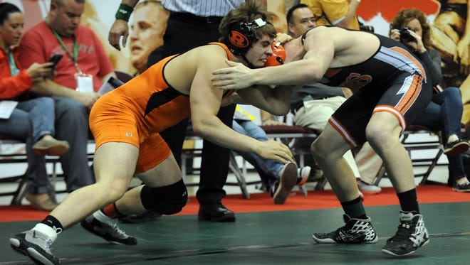 Ridge wood's Kasey Bethel wrestles Versailles Jonathan Moorman during the Division III Champion Preliminaries at the Individual State Wrestling Tournament, Thursday, March 9, 2017, at the Jerome Schottenstein Center in Columbus.