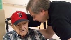 Nick Bonanno, right, talks with his father World War