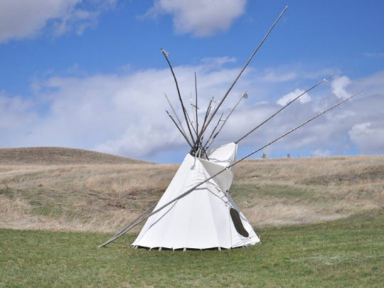 Visitors to the First Peoples Buffalo Jump State Park