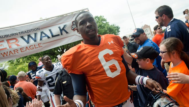 Auburn quarterback Jeremy Johnson high fives fans during Tiger Walk before Auburn A-Day spring game on Saturday, April 18, 2015, in Auburn, Ala.