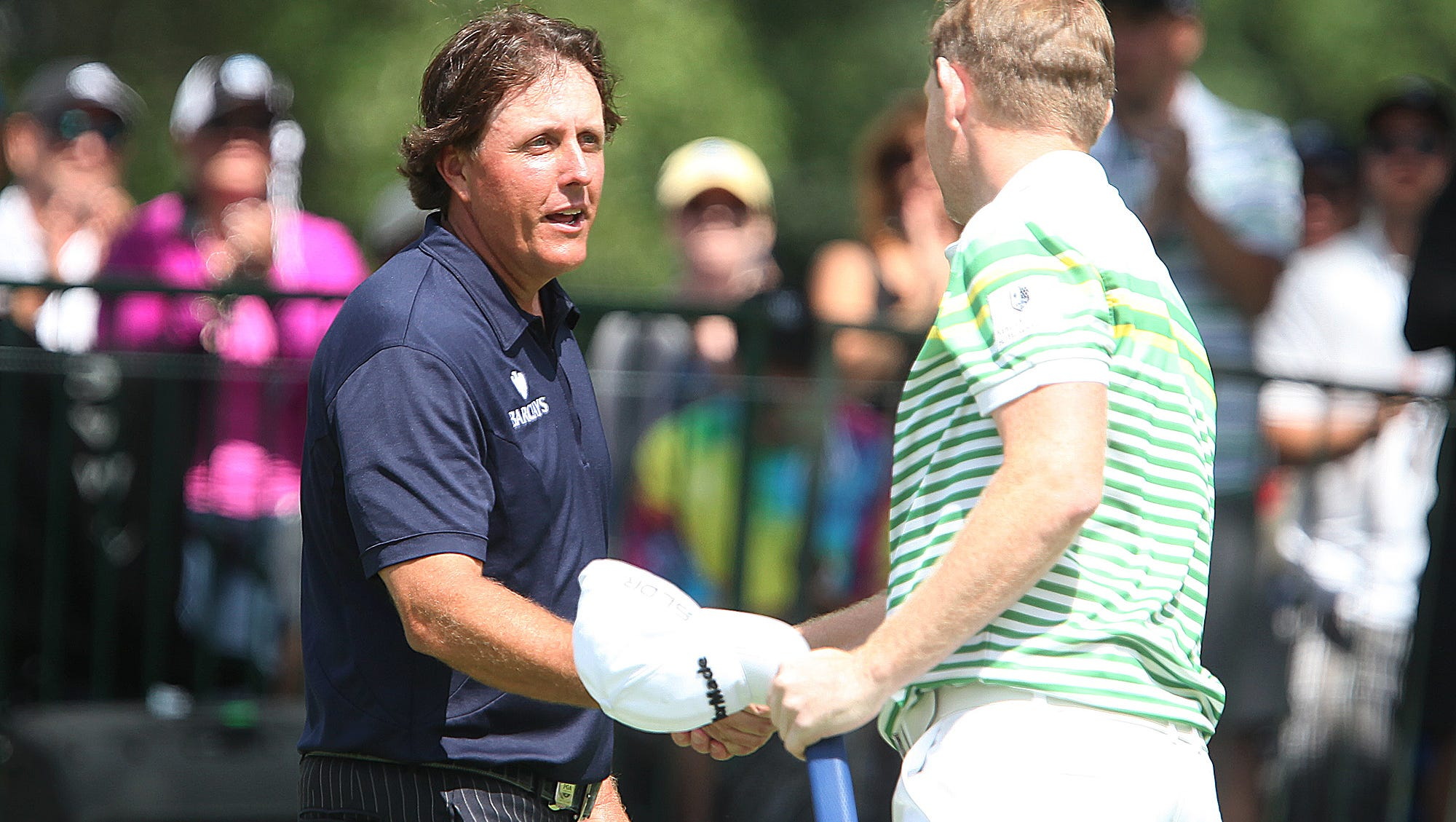 Phil Mickelson shakes hands with Stephen Gallacher after they finished their round on 18 Sunday.
