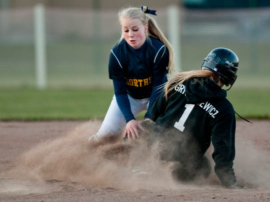 Port Huron's Sydney Grygorcewicz slides safely into second base in front of Northern's Heidi Wilson during a softball game Friday at Port Huron High School.