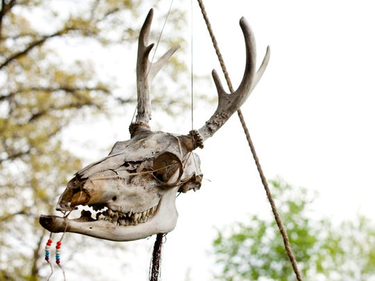 A skull hangs in front of Canton resident Leonard Darnell's campsite in preparation for the annual Port Huron event.