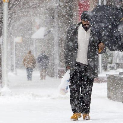 Jamal Batten walks down Delaware Ave. in Wilmington