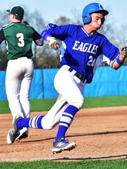 Lakeland's Tyler Cleasby (right) motors around third