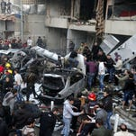 Lebanese people gather at the site of a car bomb that targeted Beirut's southern suburb of Haret Hreik on Jan. 2.
