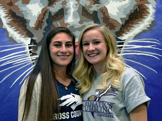 Spanish Springs athletes Alexis Melendrez, left, and Kloey Smith signed letters of intent during a ceremony at the school on Tuesday. Alexis Melendrez will attend Nevada for cross country and track. Kloey Smith signed with Converse College in Spartanburg, SC for acro and tumbling.