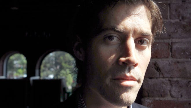 "This May 27, 2011 file photo shows American journalist James Foley, of Rochester, N.H., in Boston. Journalists James Foley and Peter Theo Curtis all shared one thing in common when they were captured by Islamic militants in Syria, the title ""freelance journalist."""