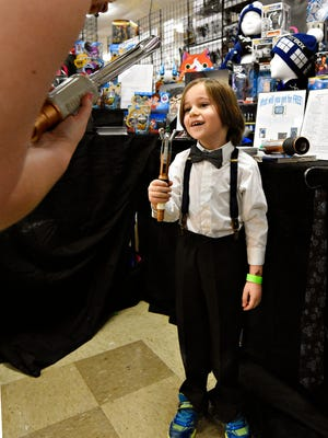 Anakin LeFevre (Dr. Who #11), 5, of Lancaster, holds up his sonic screwdriver during Comic Con at Old Main in York City on Sunday, March 6, 2016. Dawn J. Sagert photo