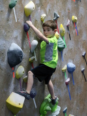 The Gravity Vault  is an indoor rock gym located in Middletown .People are photographed on Wednesday March 23, 2016 using the facilities.Here 7 year old Josh Platko of Matawan climbs up one of the wall during a rock climbing class at the gym.