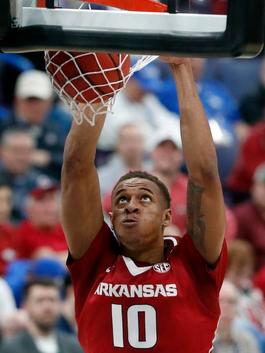 FILE - In this March 9, 2018, file photo, Arkansas' Daniel Gafford dunks during the second half of an NCAA college basketball game against Florida in the quarterfinals of the Southeastern Conference tournament in St. Louis. Gafford says he will return to the Razorbacks next season, ending speculation about whether the freshman would leave for the NBA after one year in college. (AP Photo/Jeff Roberson, File)