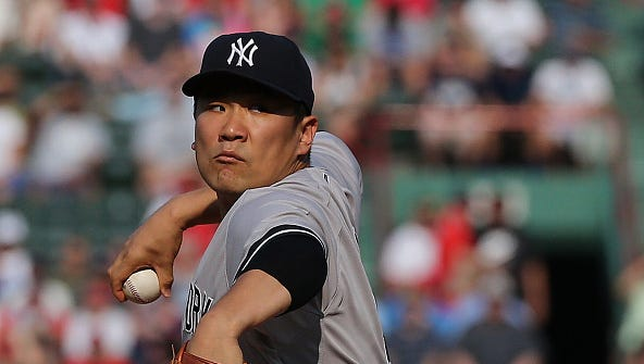 Masahiro Tanaka of the New York Yankees throws in the first inning against he Boston Red Sox at Fenway Park on September 2, 2015 in Boston, Massachusetts.